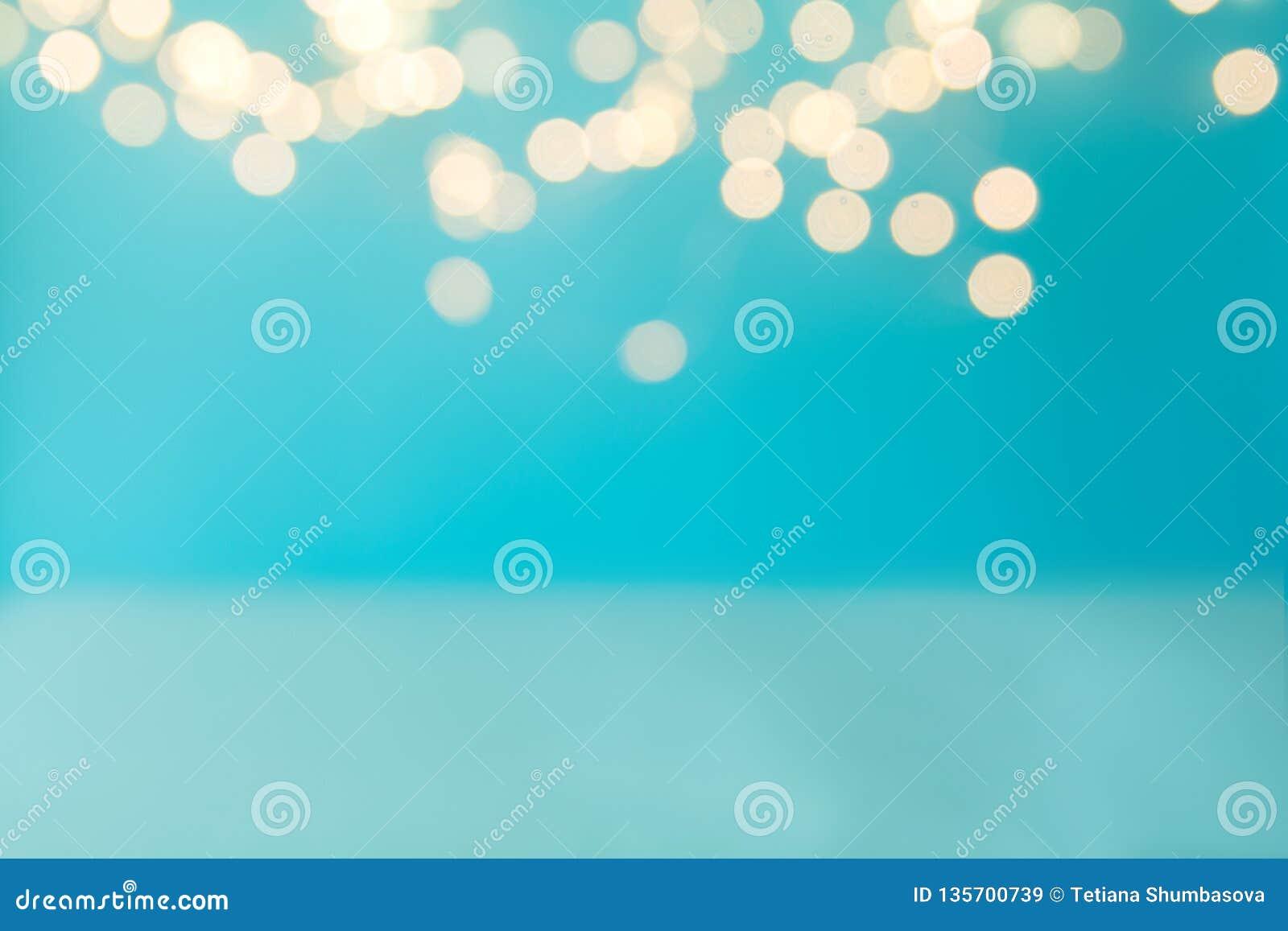 Blue background against defocused light. Holiday celebration concept. Copy space