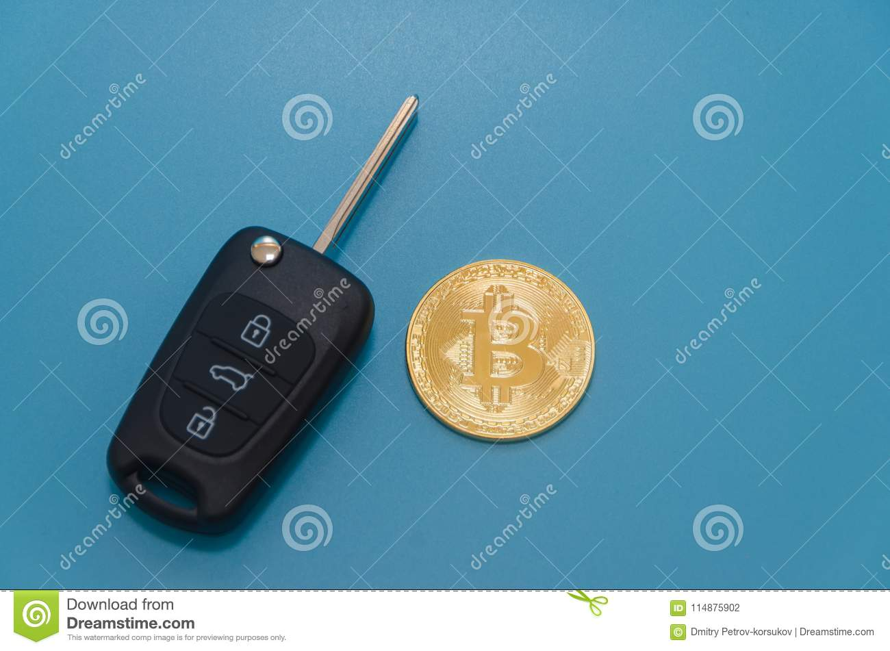 Car Key And Cryptocurrency Gold Bitcoin, On Blue Background