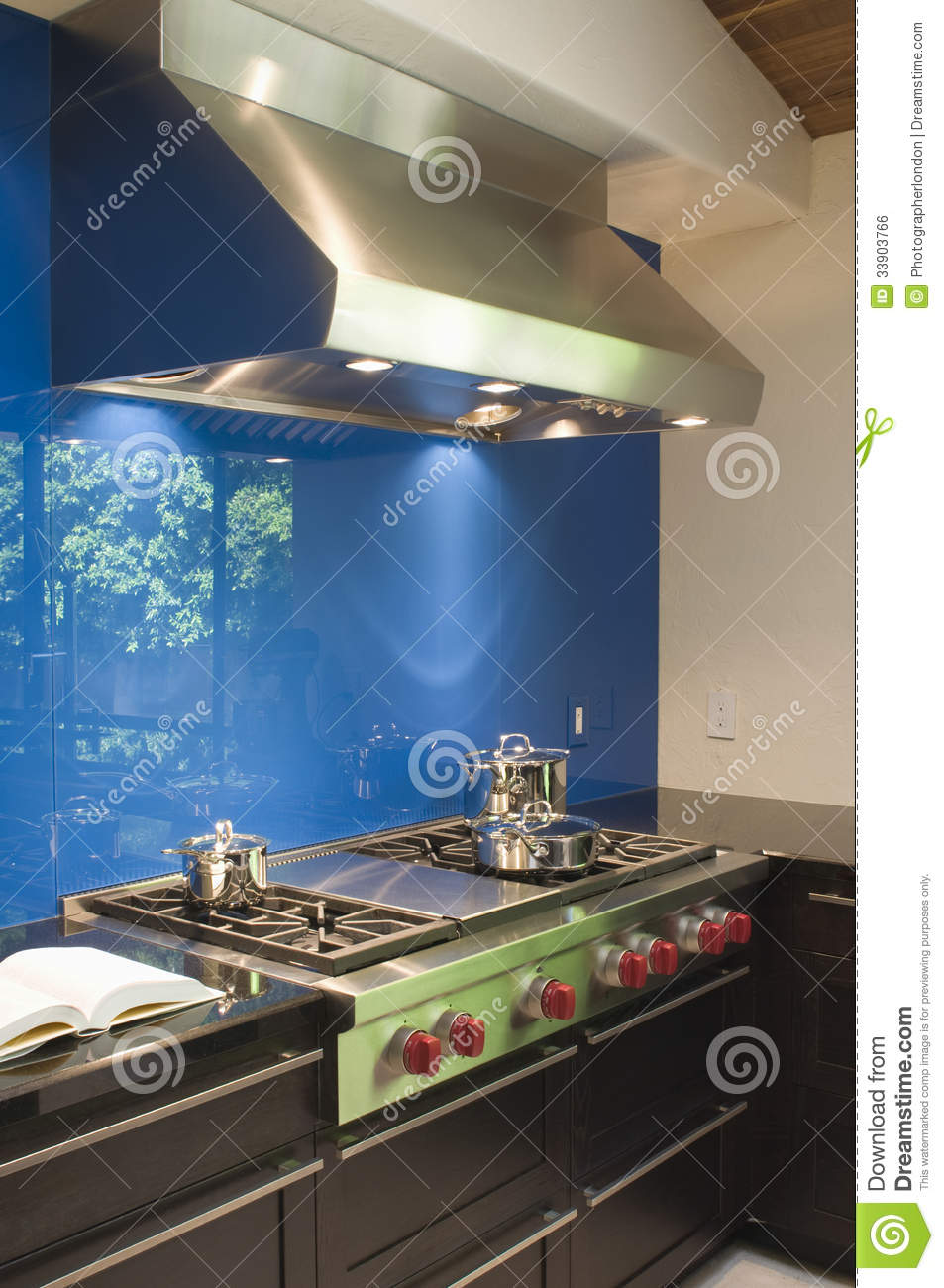 Blue Backsplash And Stainless Steel Vent Hood Stock Photo - Image of ...