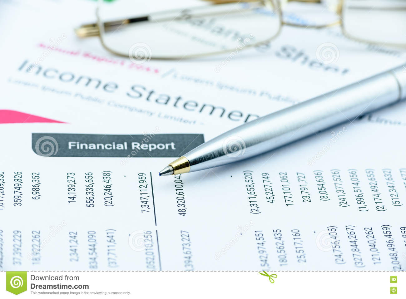 Blue Ballpoint Pen On A Quarterly Corporate Financial Report Diagram Table