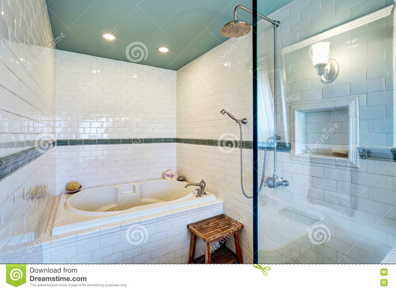 Blue Bathroom Interior With White Tile Trim Wall, Glass Cabin Shower ...