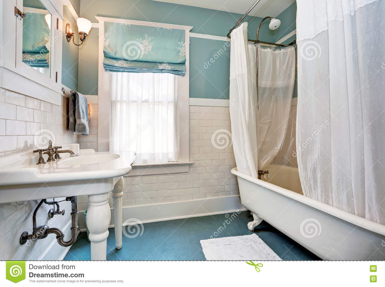 Blue Bathroom Interior With White Tile Trim Wall, White Sink And ...