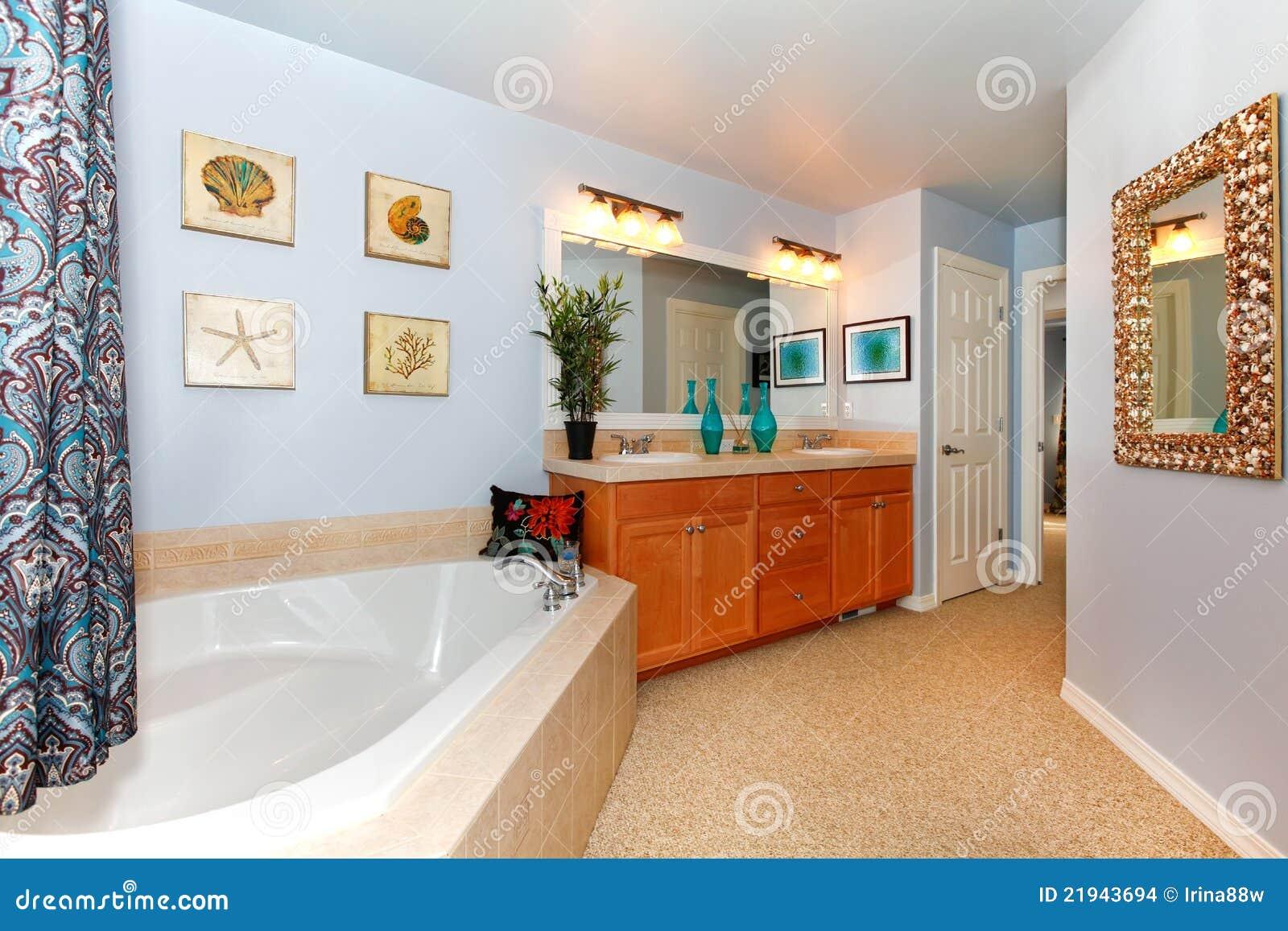 Blue Bathroom With Large Triangle Tub Stock Photo - Image of bath ...