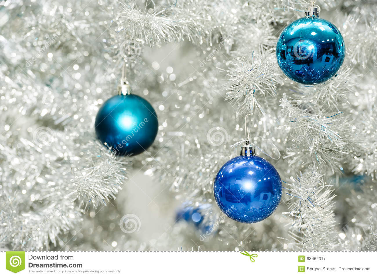 Blue Baubles On Silver Artificial Christmas Tree Stock