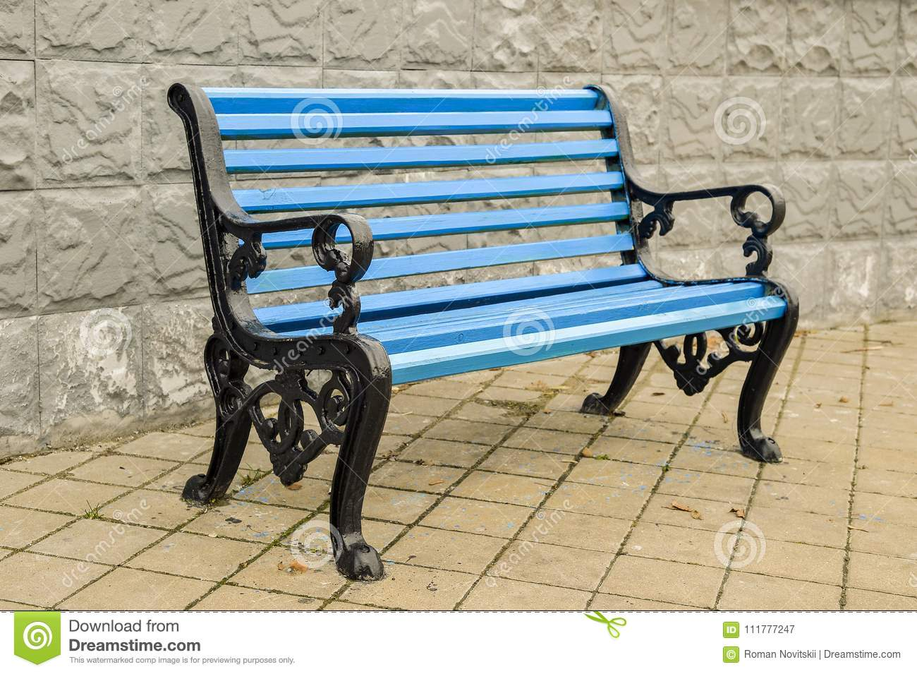 The blue bench in the Park on the tiled pavement. No body.