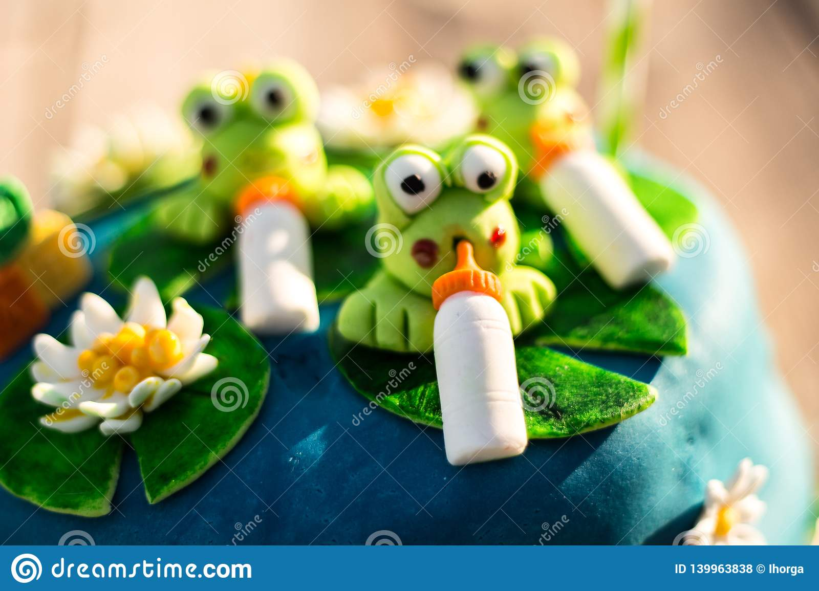Fantastic A Blue Birthday Cake With Green Frogs Figures Stock Photo Image Personalised Birthday Cards Epsylily Jamesorg