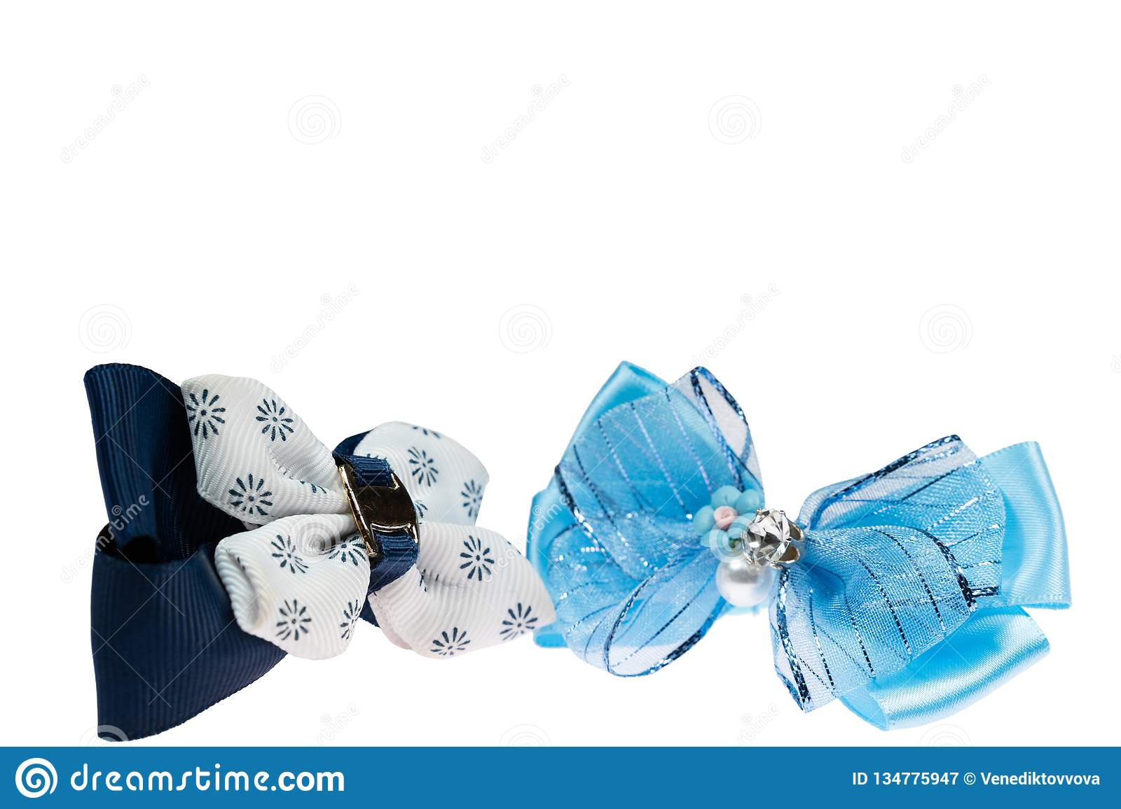 Blue and black bow hair bands on white isolated background