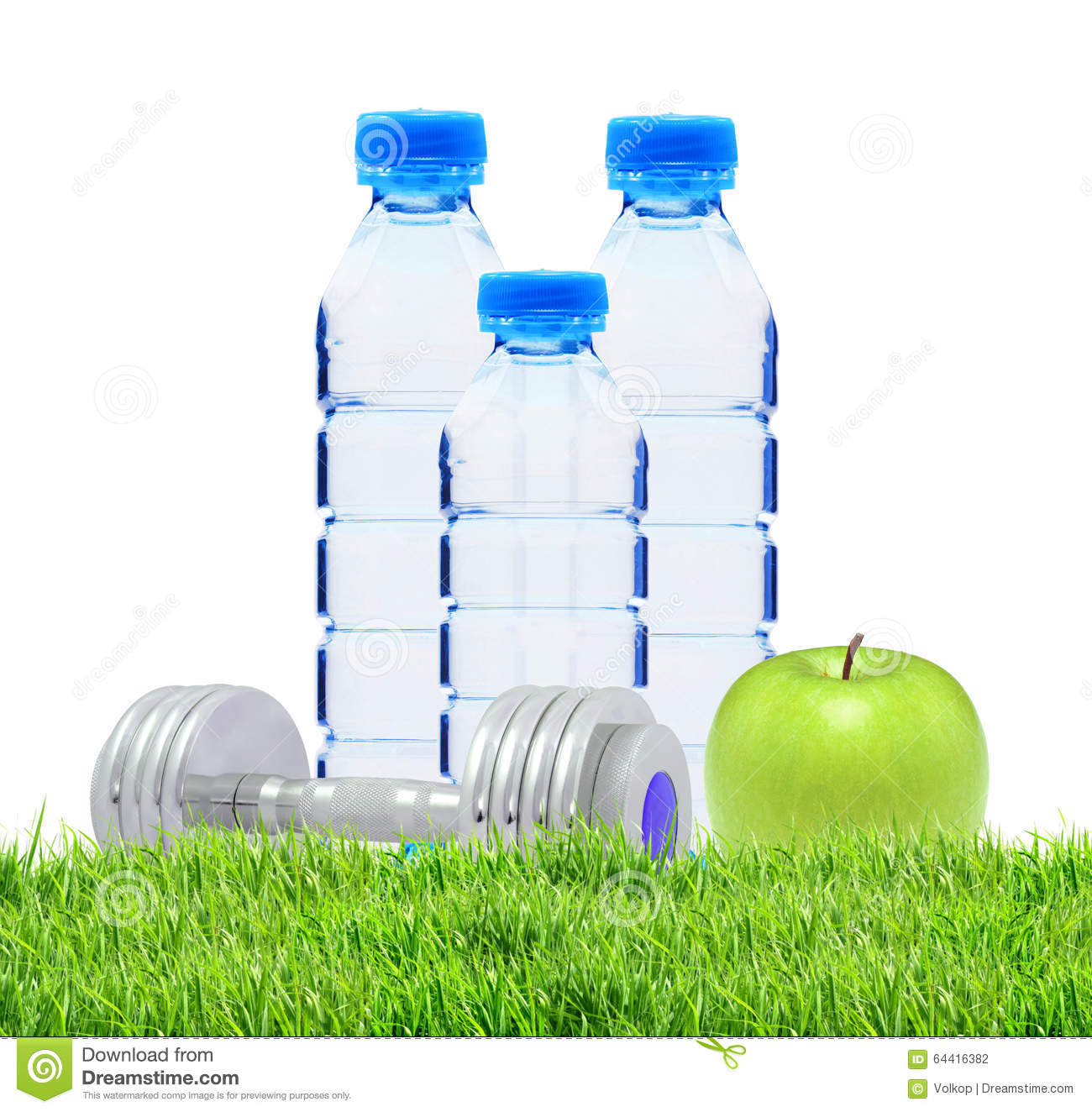 Bottle of sparkling water and green apple isolated stock