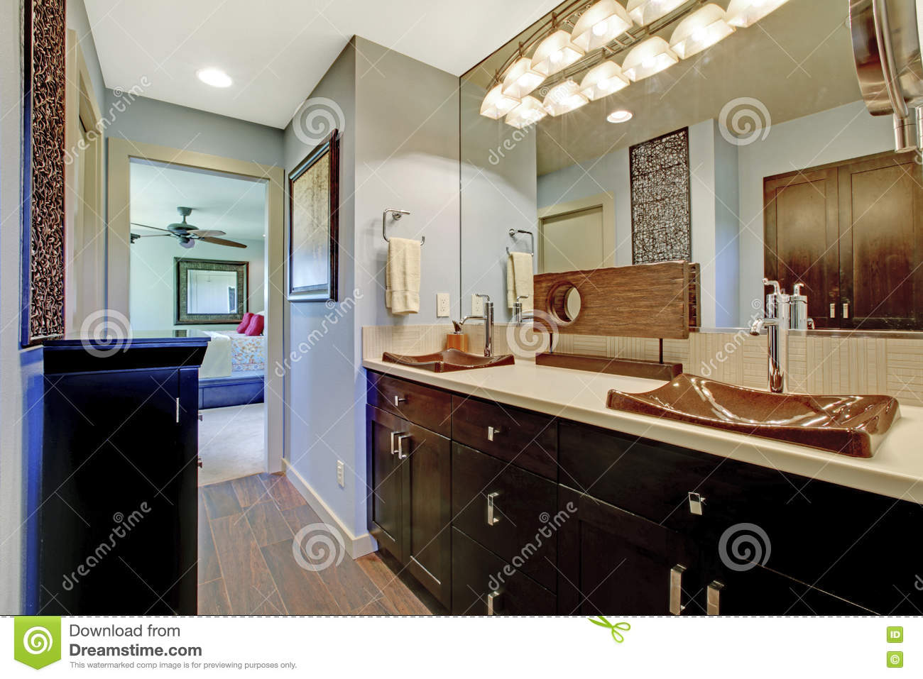 blue and brown bathroom interior with black brown cabinets and large mirror stock photo image. Black Bedroom Furniture Sets. Home Design Ideas