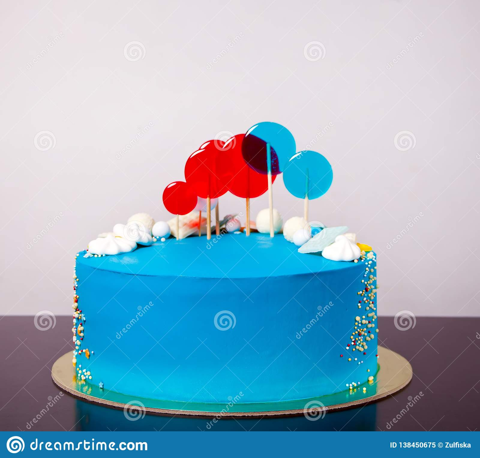 Miraculous Blue Buttercream Birthday Cake With Colorful Lollipops Stock Image Birthday Cards Printable Inklcafe Filternl