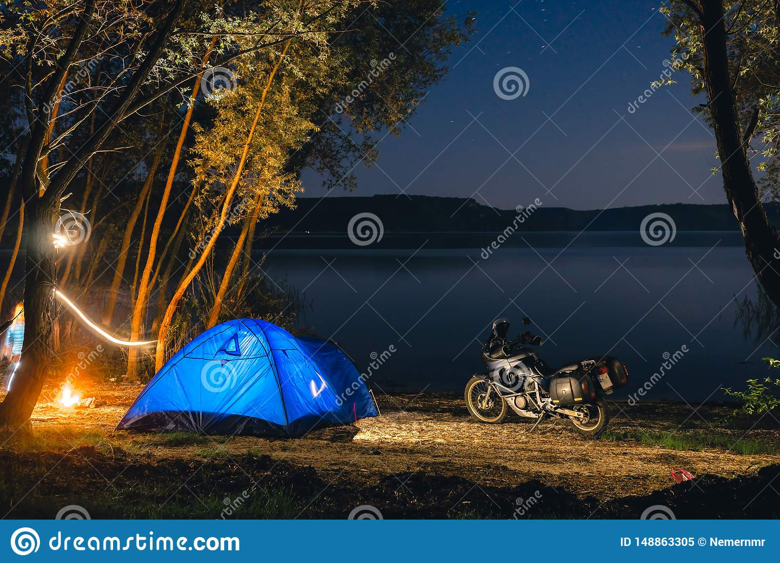 Blue Camping Tent Illuminated Inside. Night Hours Campsite ...