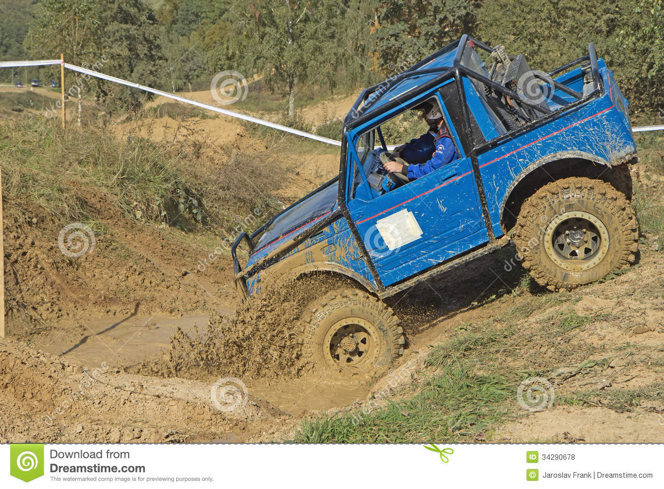blue car  entering    puddle  mud editorial stock photo image