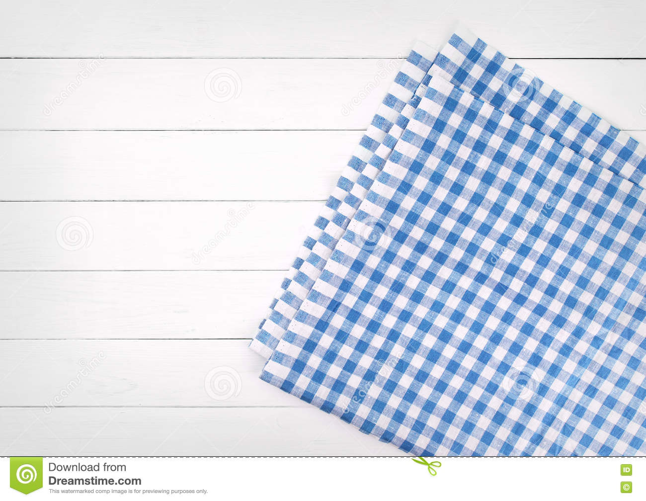Blue Checkered Folded Tablecloth On White Wooden Table Top View