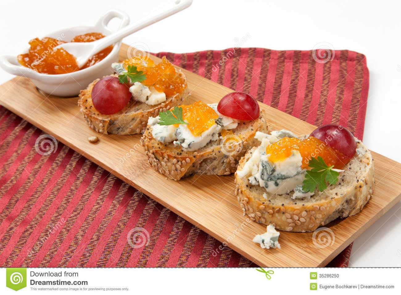 Blue cheese and apricot jam multigrain crostini with grapes and ...