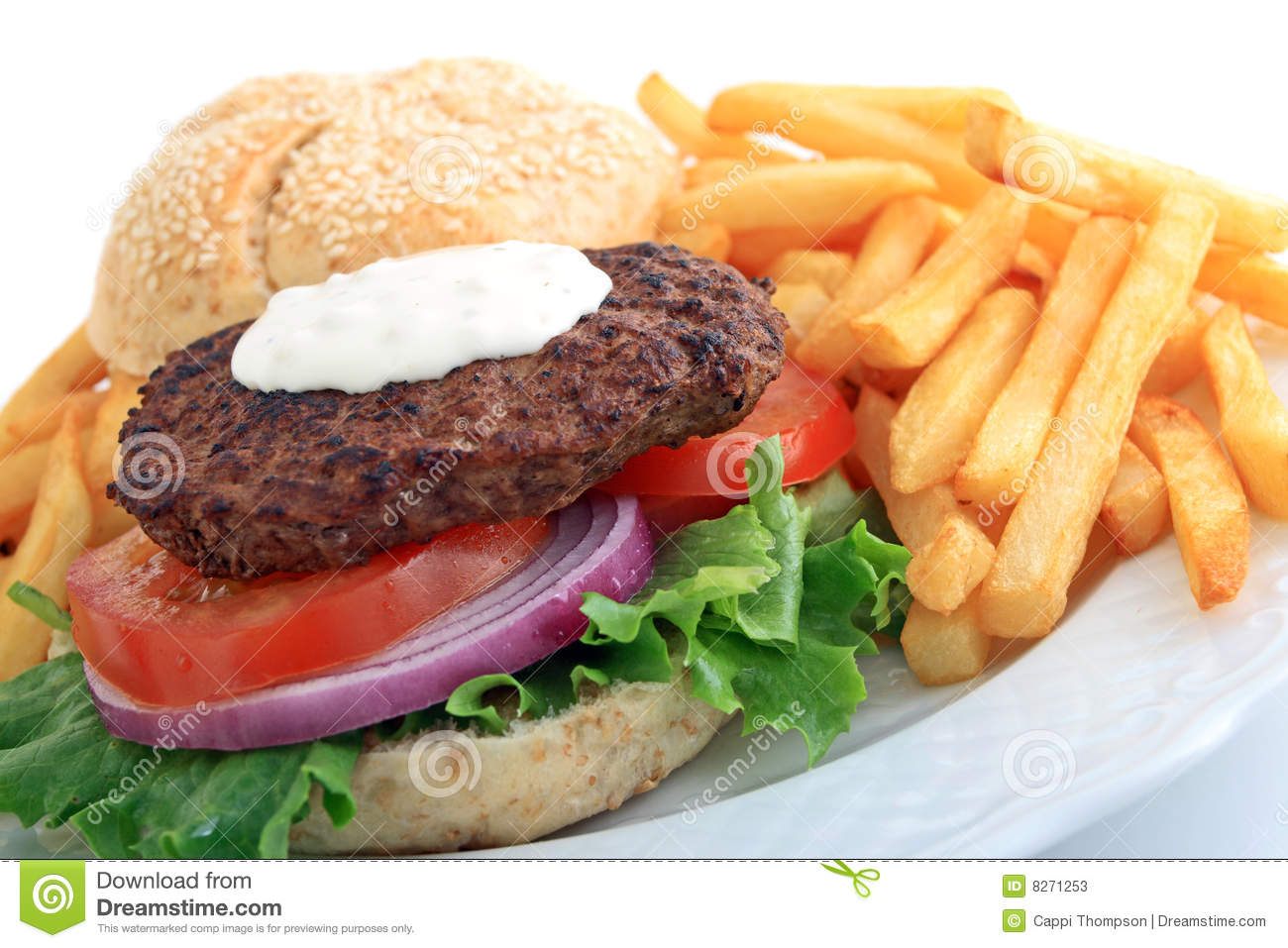 Hamburger with chunky blue cheese salad dressing, lettuce, tomato, and ...