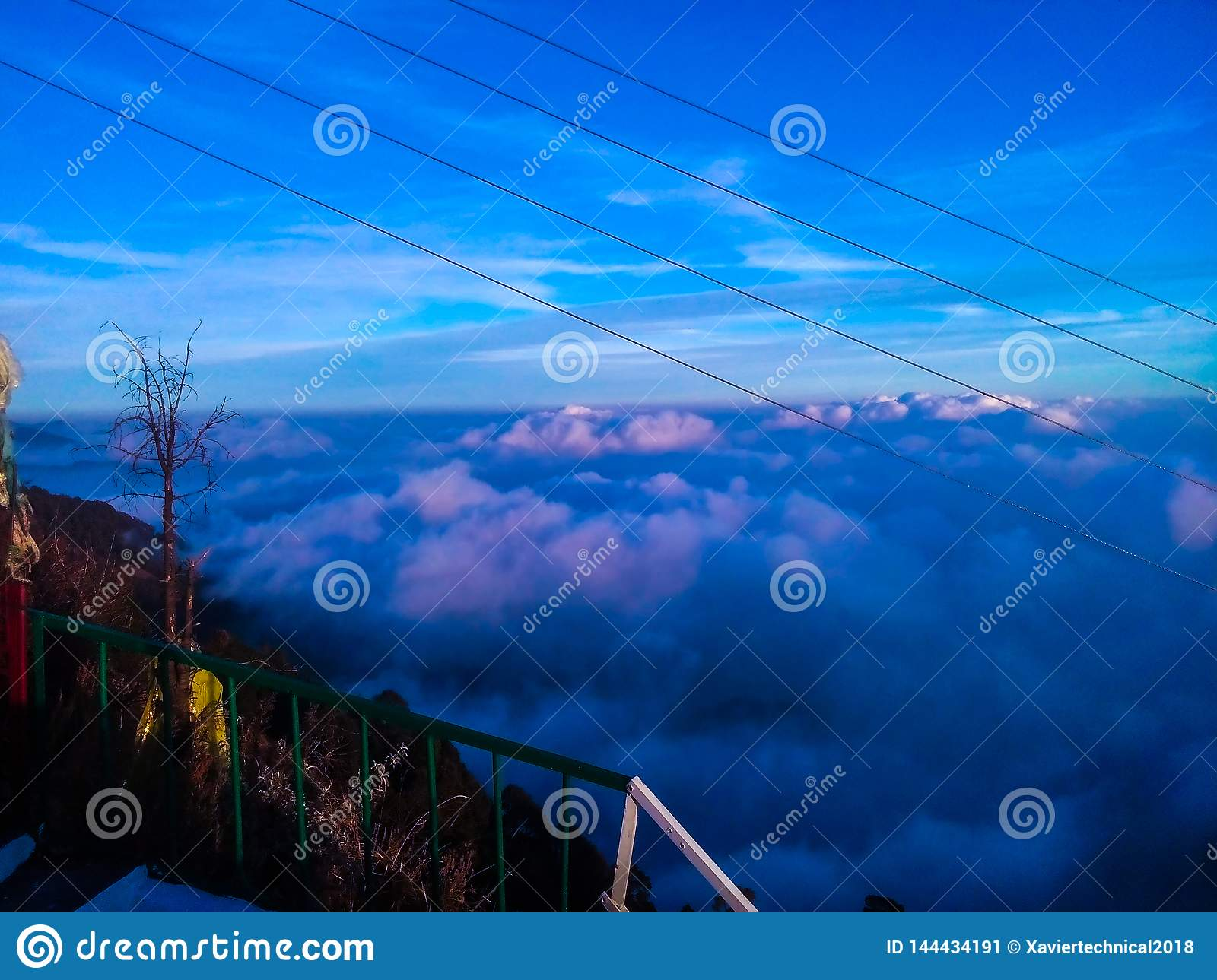 Blue clouds over mountains in evening shadow