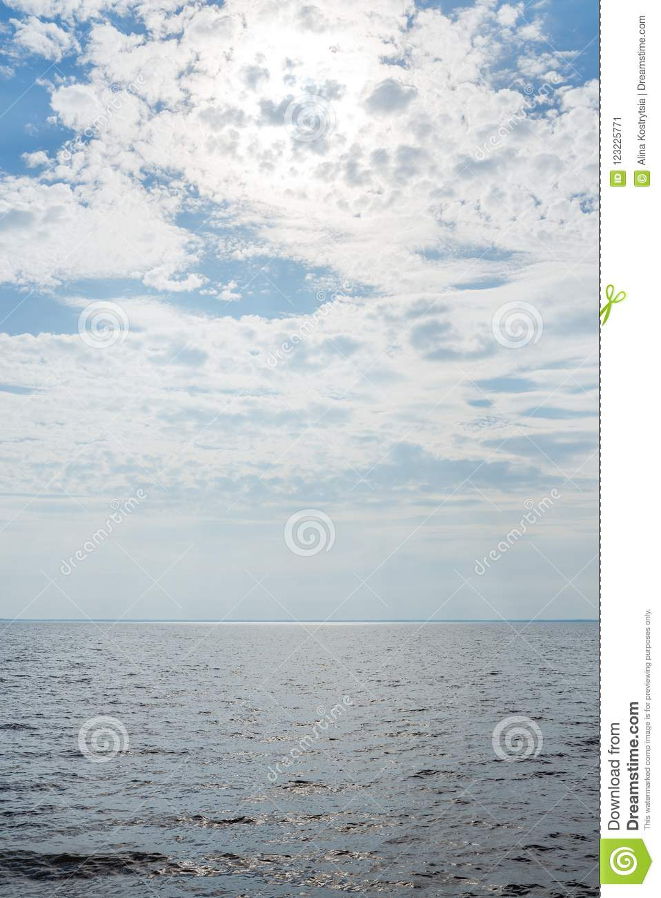 Blue cloudy sky over a wide river