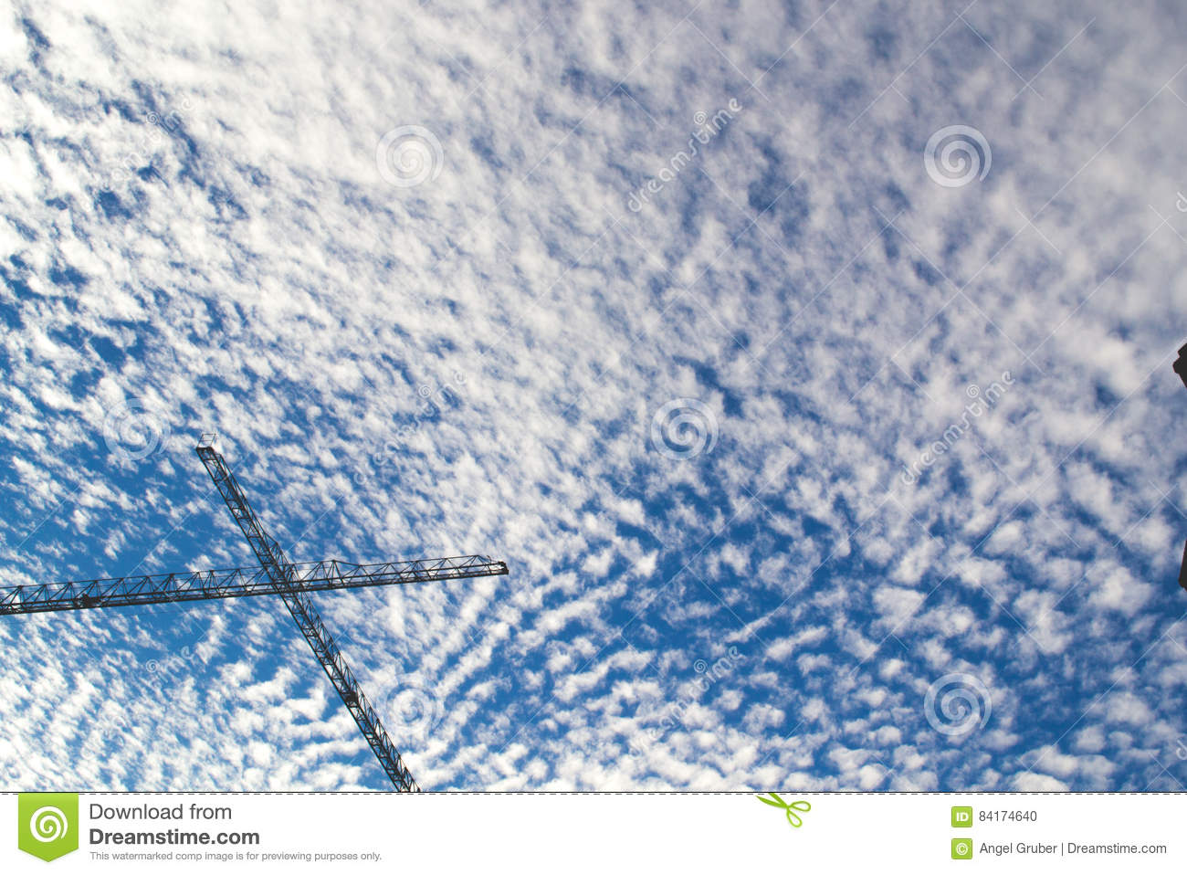 Blue cloudy sky with scaffold