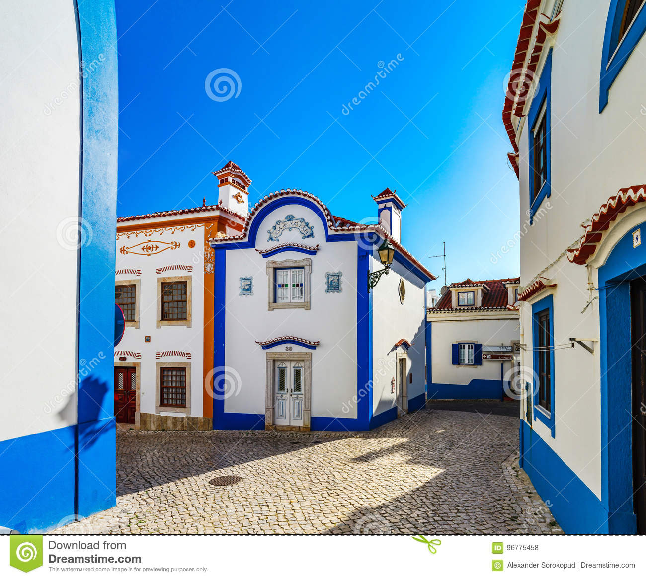 Blue color on the sky and buildings of old city Ericeira