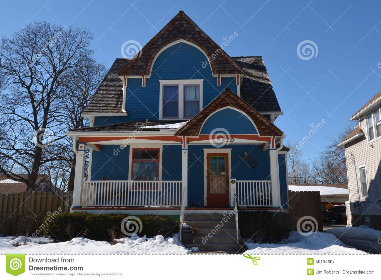 Blue cottage in snow editorial photography image 50194607 for Housse illinois