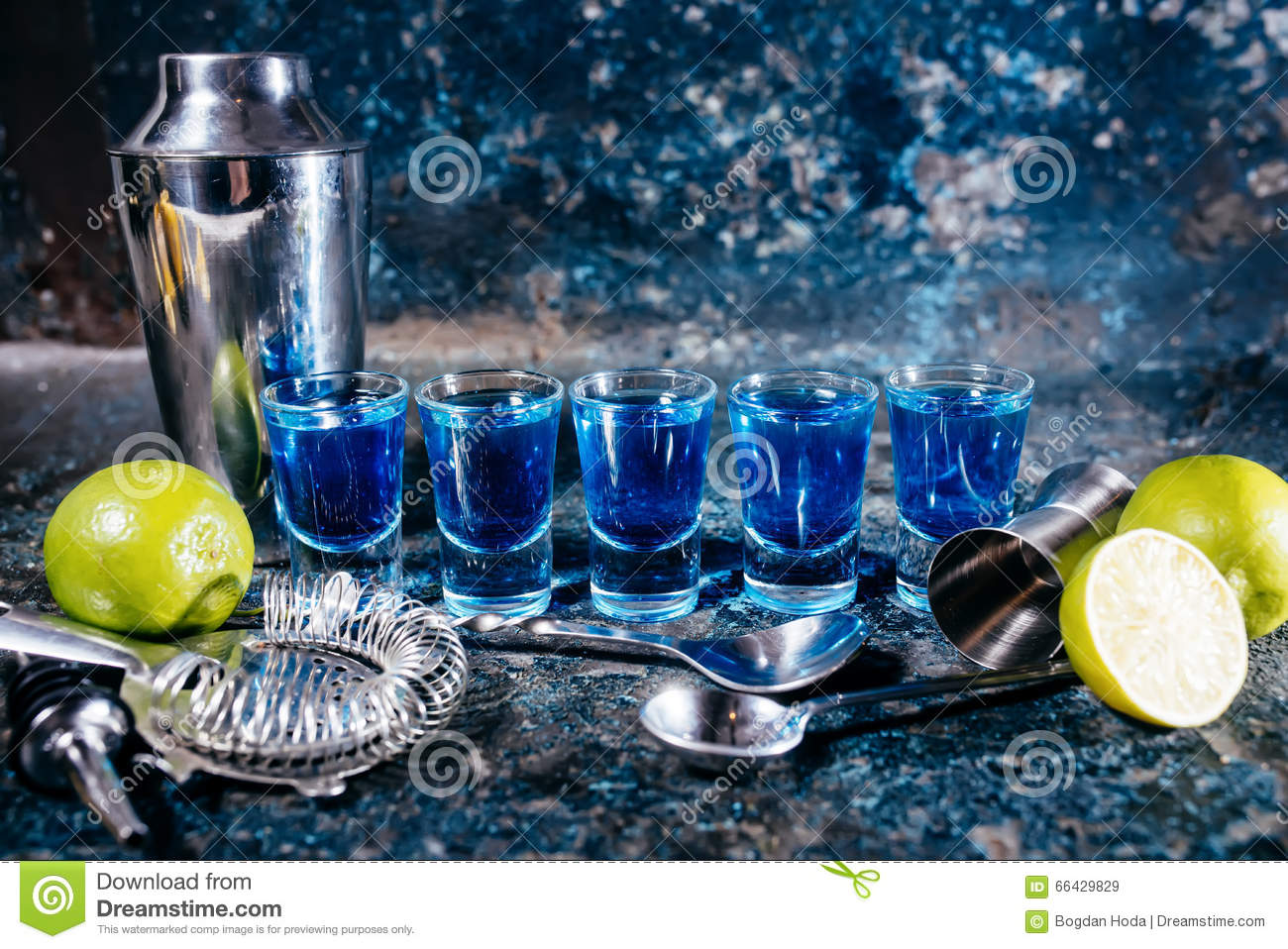 Blue curacao, alcoholic strong drinks. Cocktails and garnish at bar, pub or restaurant