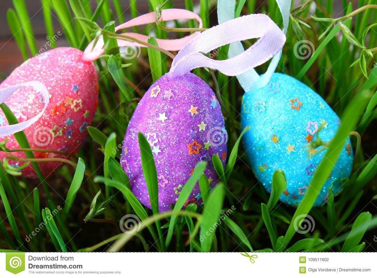 Blue decorative eggs on a background of green grass. Easter.