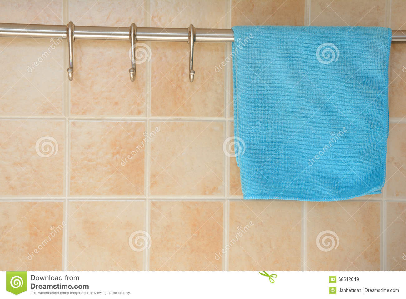 Blue dishcloth on hanger. stock image. Image of wall - 68512649