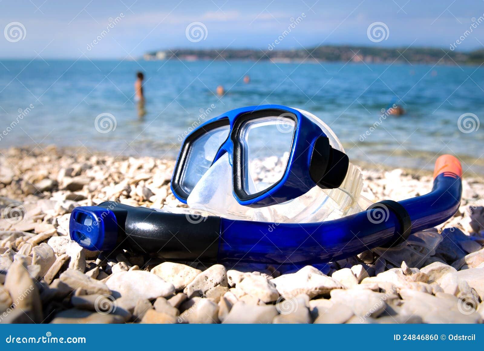 beach goggles  Blue Goggles On The Beach Sand Stock Photo - Image: 68613228