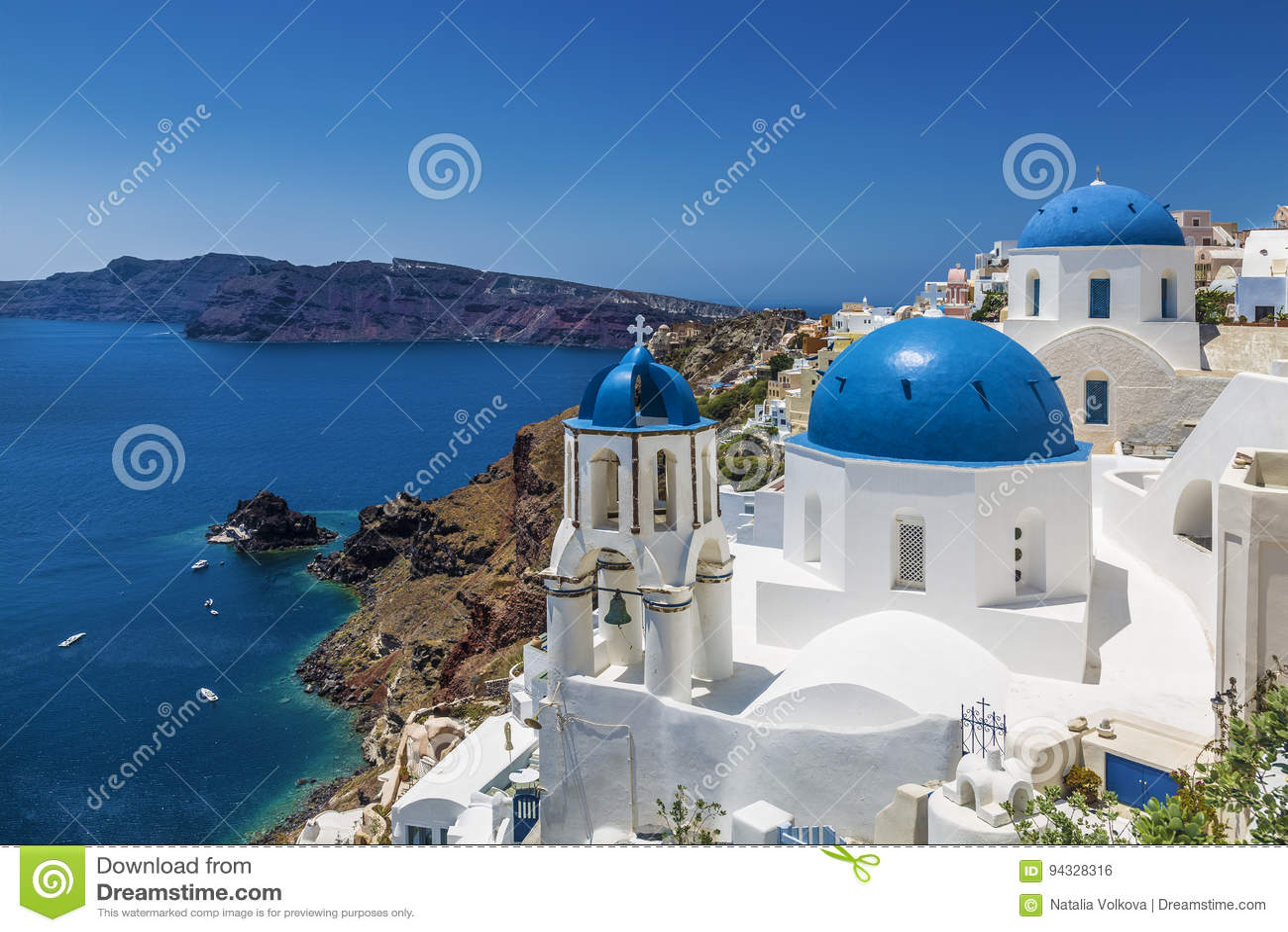 Blue domed churches in the village of Oia, Santorini Thira, Cyclades Islands, Aegean Sea,
