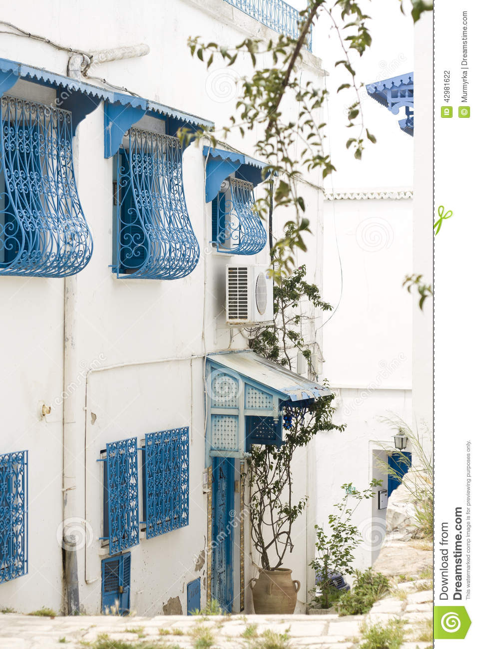 blue doors window and white wall of building in sidi bou said stock photo image 42981622. Black Bedroom Furniture Sets. Home Design Ideas