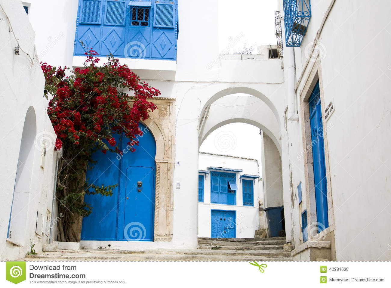 blue doors window and white wall of building in sidi bou said stock photo image 42981638. Black Bedroom Furniture Sets. Home Design Ideas