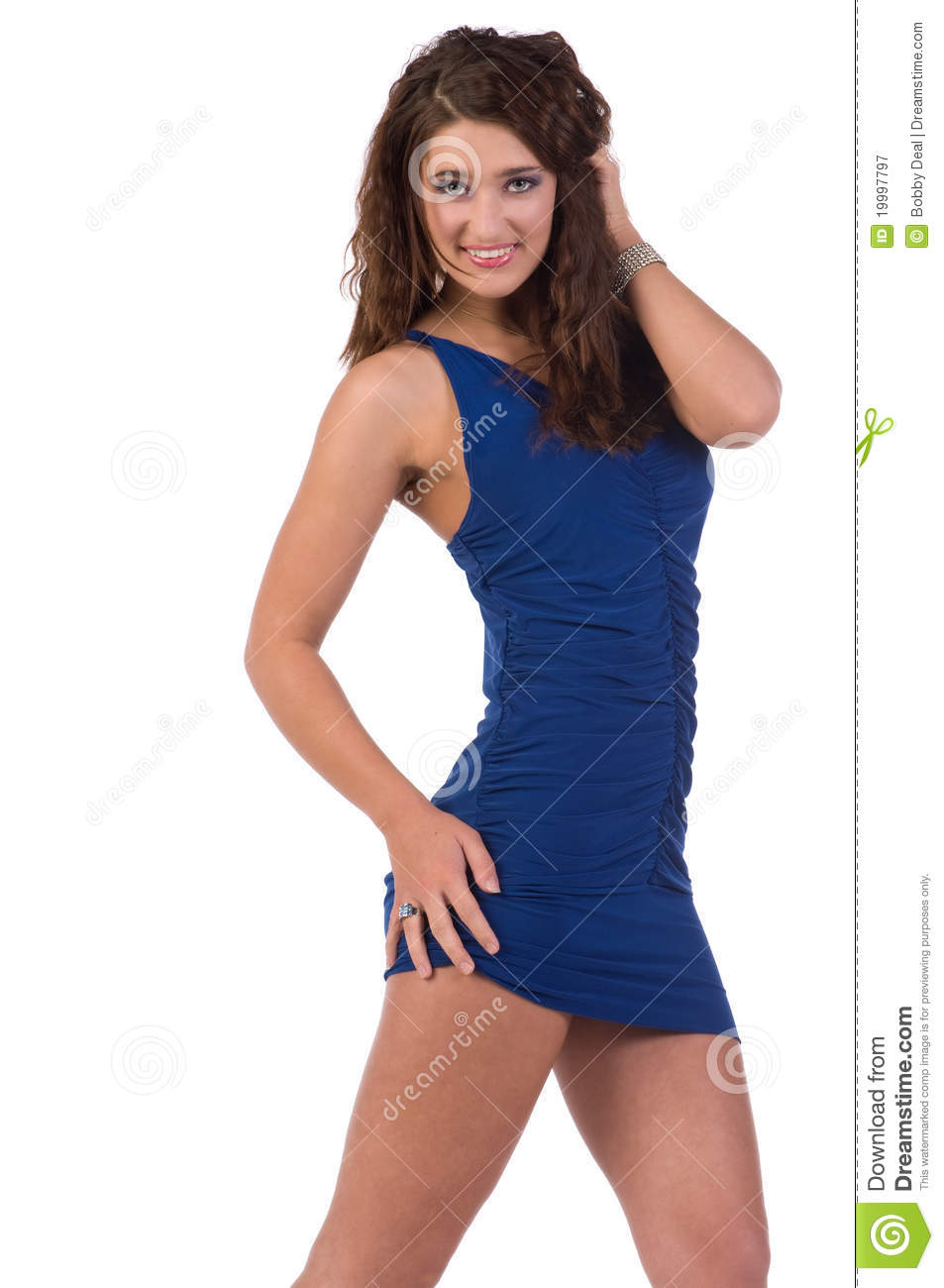 Beautiful brunette in a blue cocktail dress