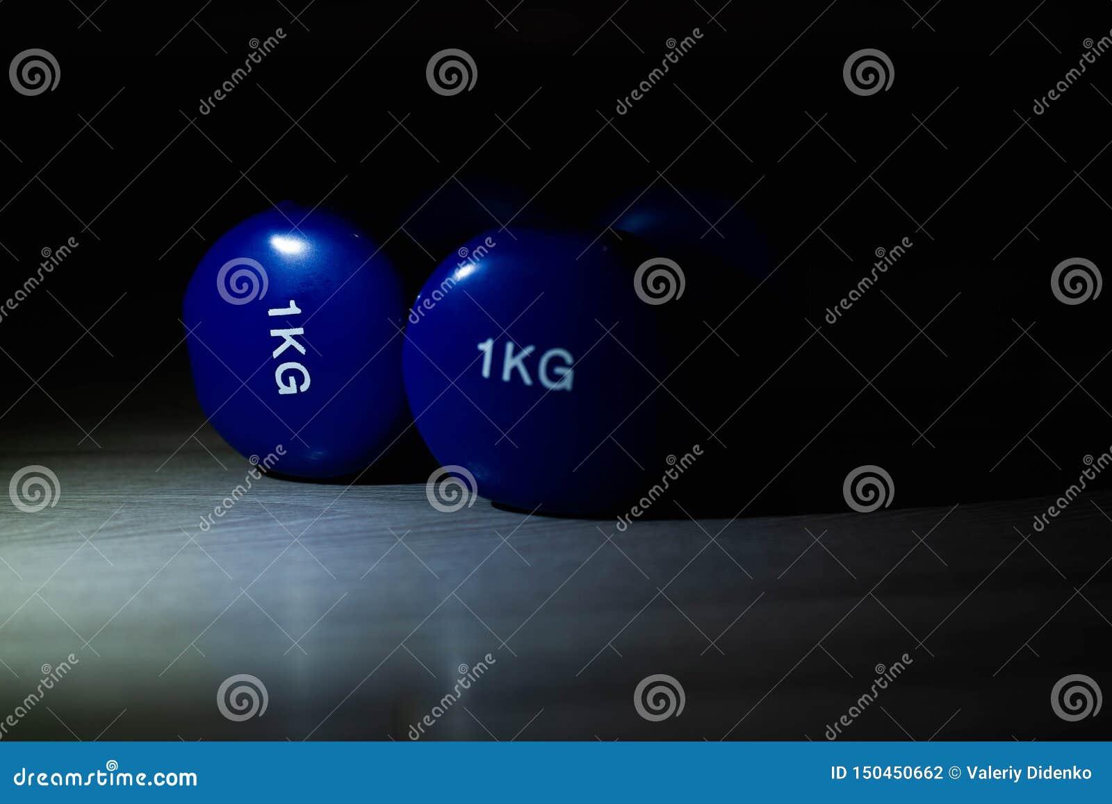 Blue dumbbells on the floor