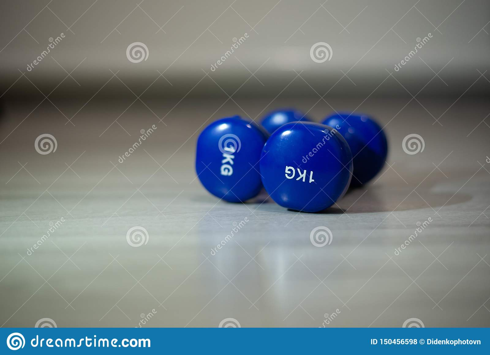 Blue dumbbells on the floor