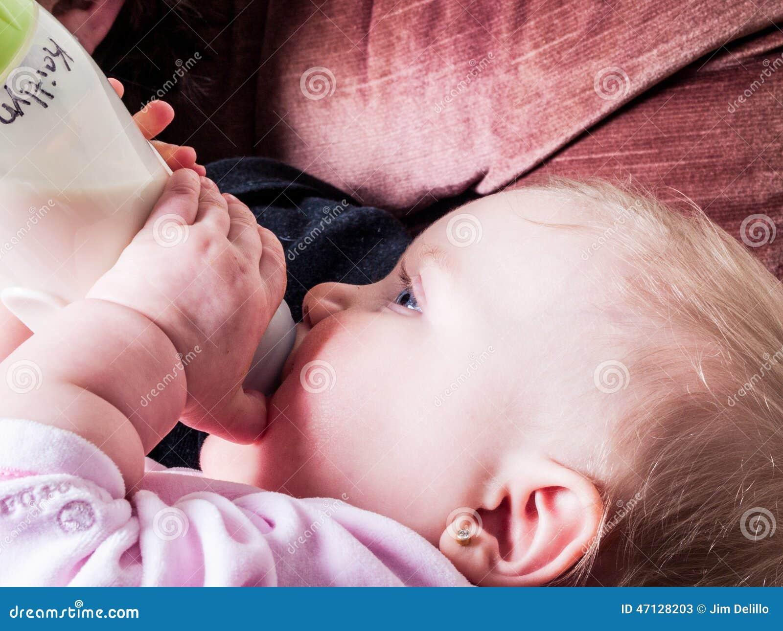 Blue-eyed Baby sucking bottle
