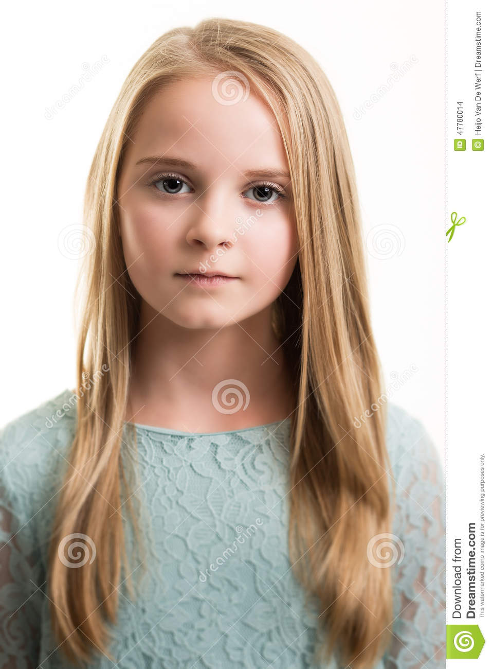 Blue Eyed Young Girl In Turquoise Top Isolated Stock Photo