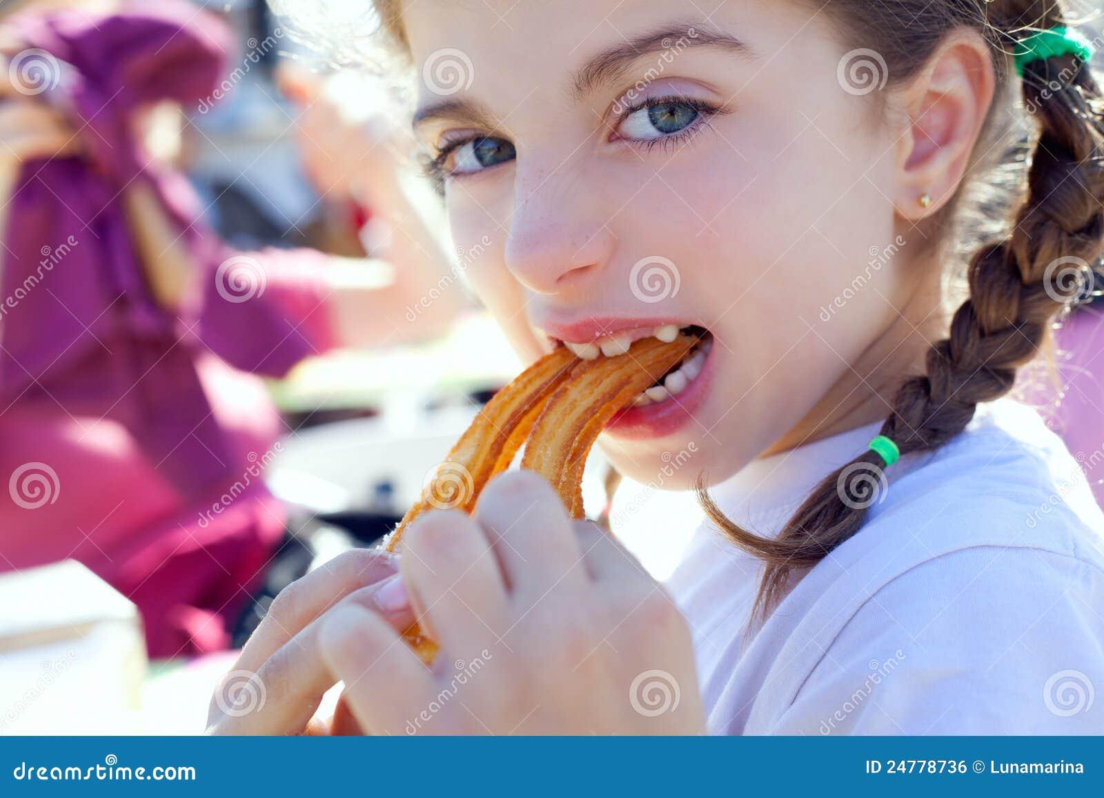 Blue Eyes Little Girl Eating Churros Smiling Royalty Free