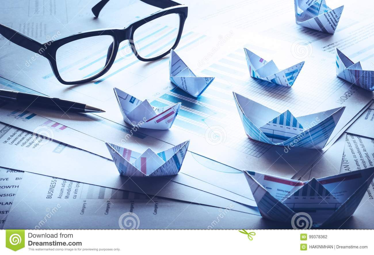 Blue filter effects images of glasses and pen with group of boat