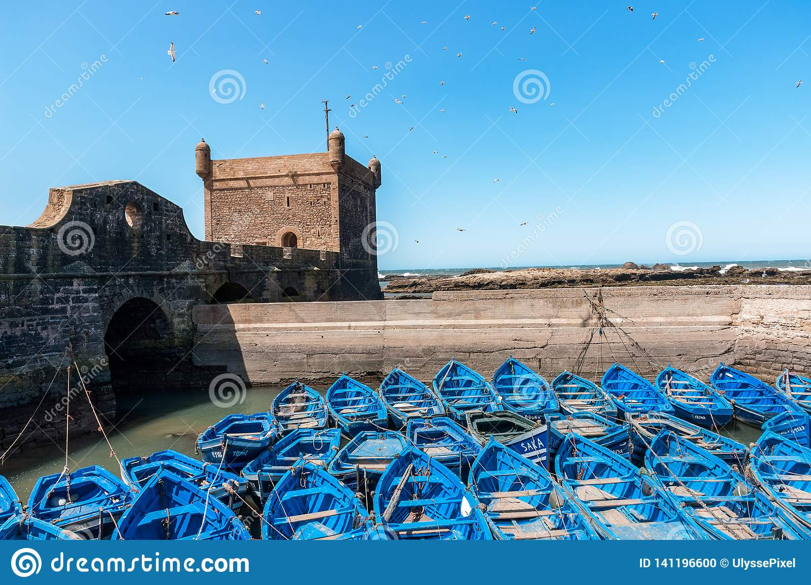 Blue Fishing boats and defensive tower in Essaouira - Morocco