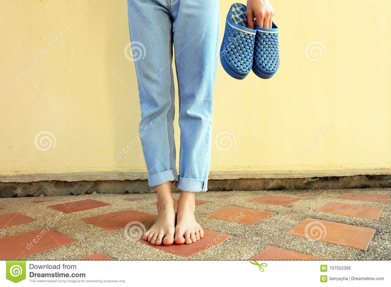bd98f4d55692 Blue flip flops fashion. Woman wear blue sandals and blue jeans stand on  the tile