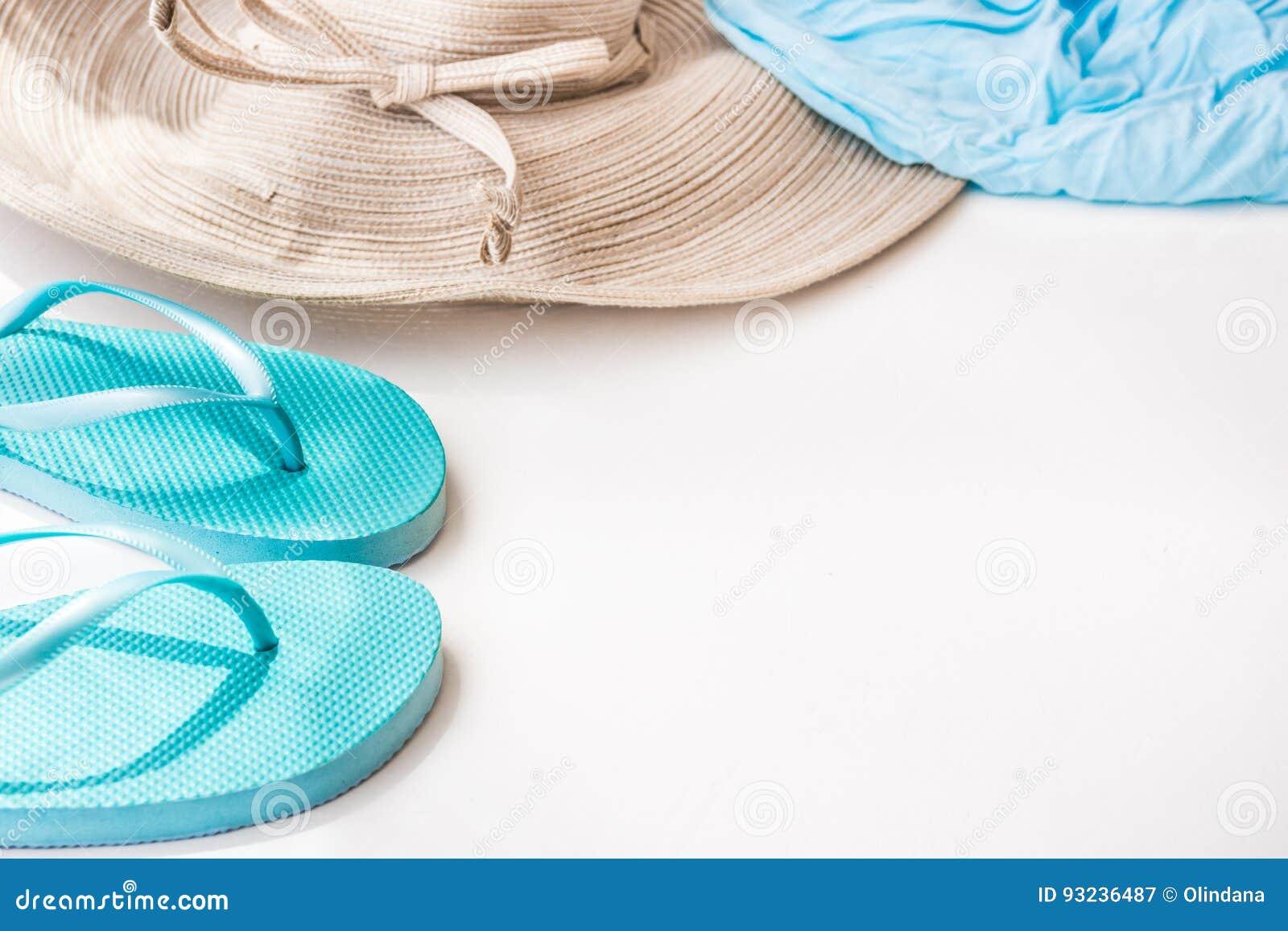 5c00be4b7 Blue Flip Flops Straw Hat Beach Wrap On White Background