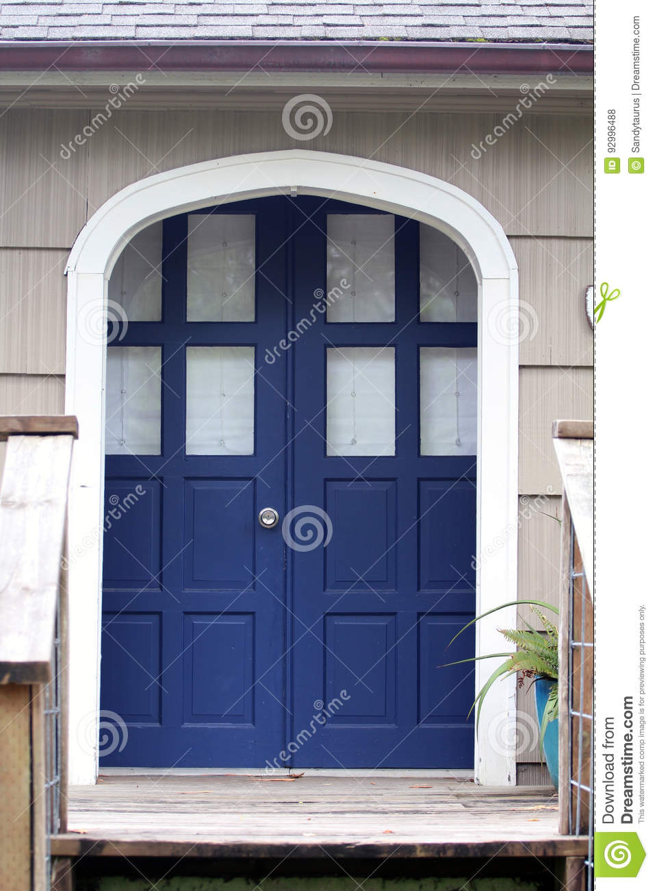 Blue Front Entry Double Doors Next To Shake Siding Stock Photo