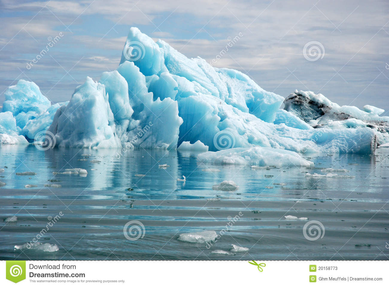 Blue glacier ice in the Jokulsarlon lagoon. Largest glacier lagoon or ...