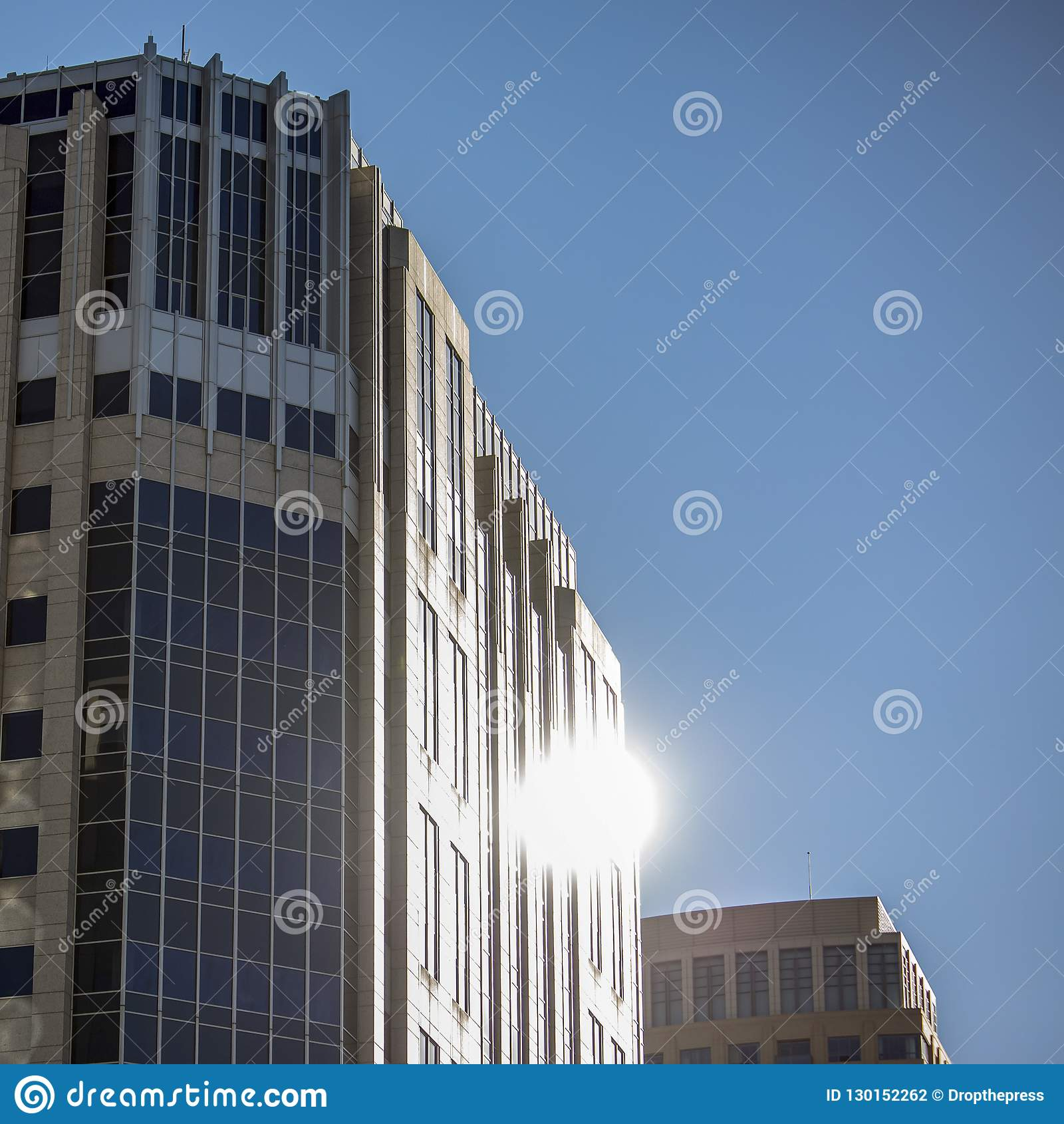 Salt Lake City Downtown Buildings: Blue Glass Building With Reflection Of The Sun Stock Photo