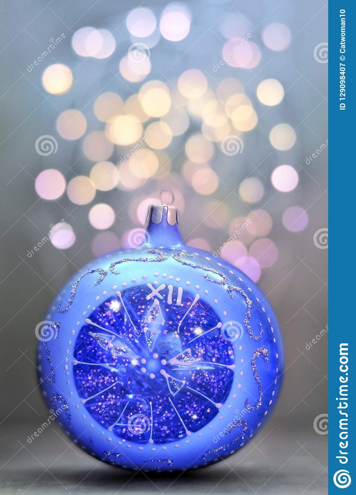 blue glitter ball on blue background christmas and new year card