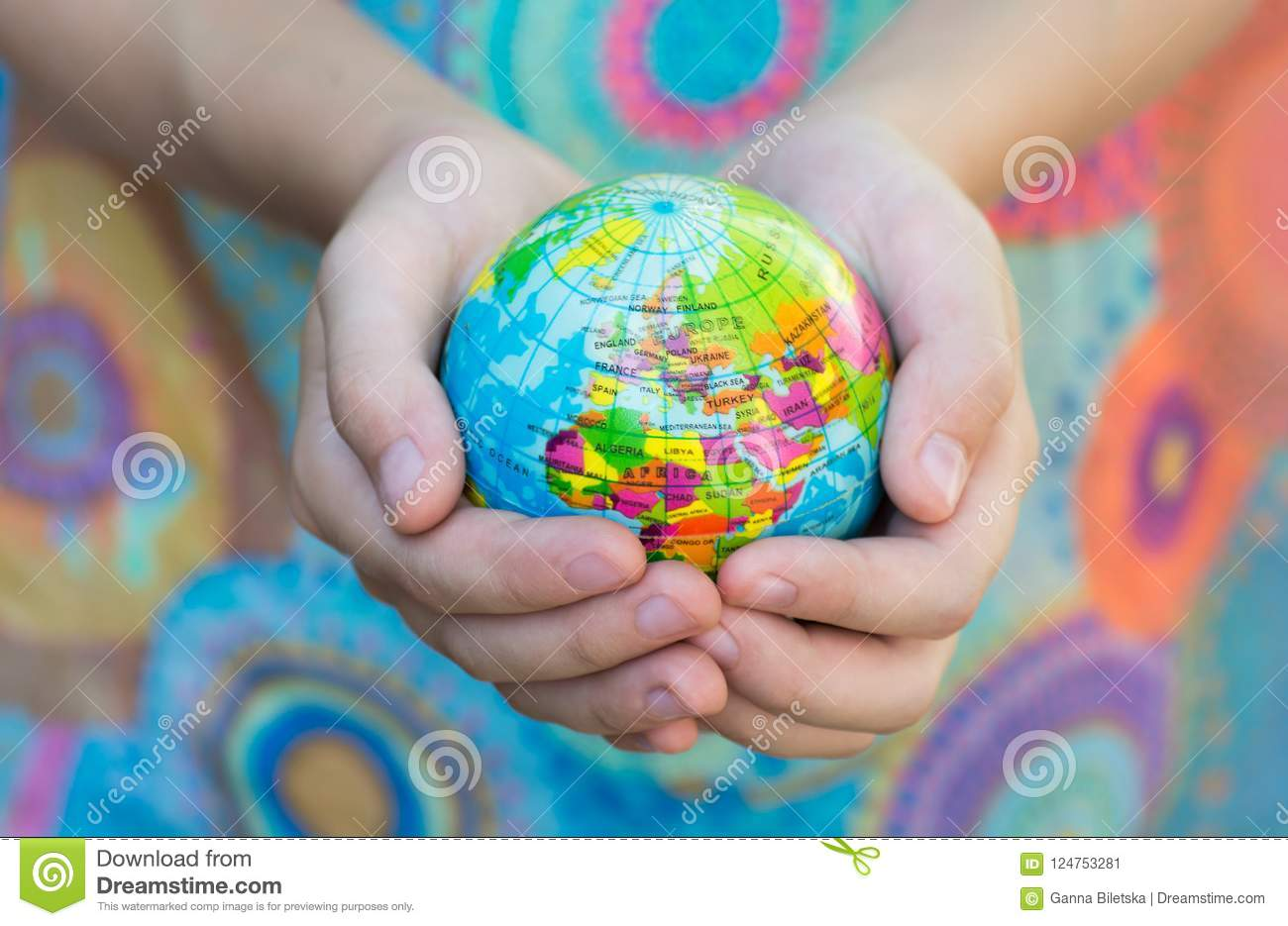 The Blue Globe with the territories of the countries of the World on a colorful background,