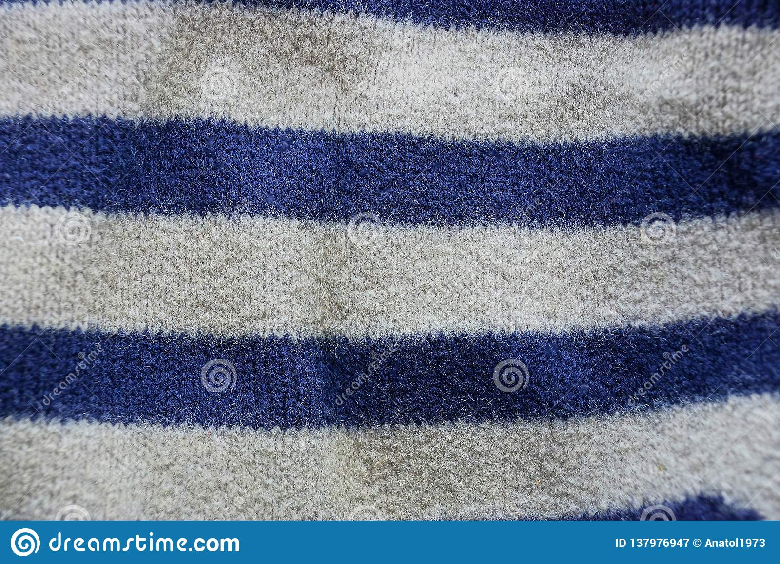 Blue gray striped fabric texture of a piece of wool on clothes