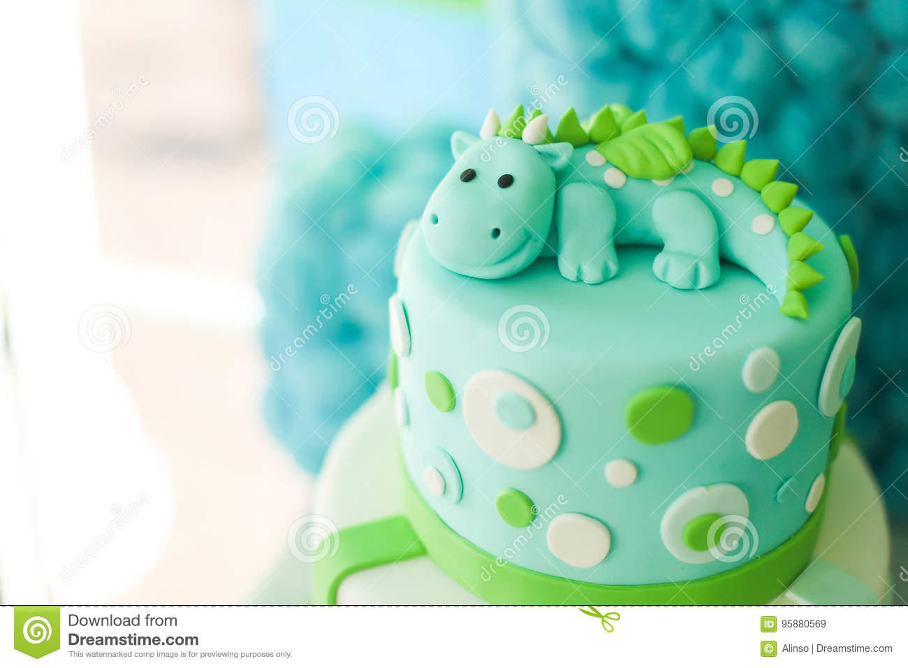 Blue and green birthday cake with cute dragon