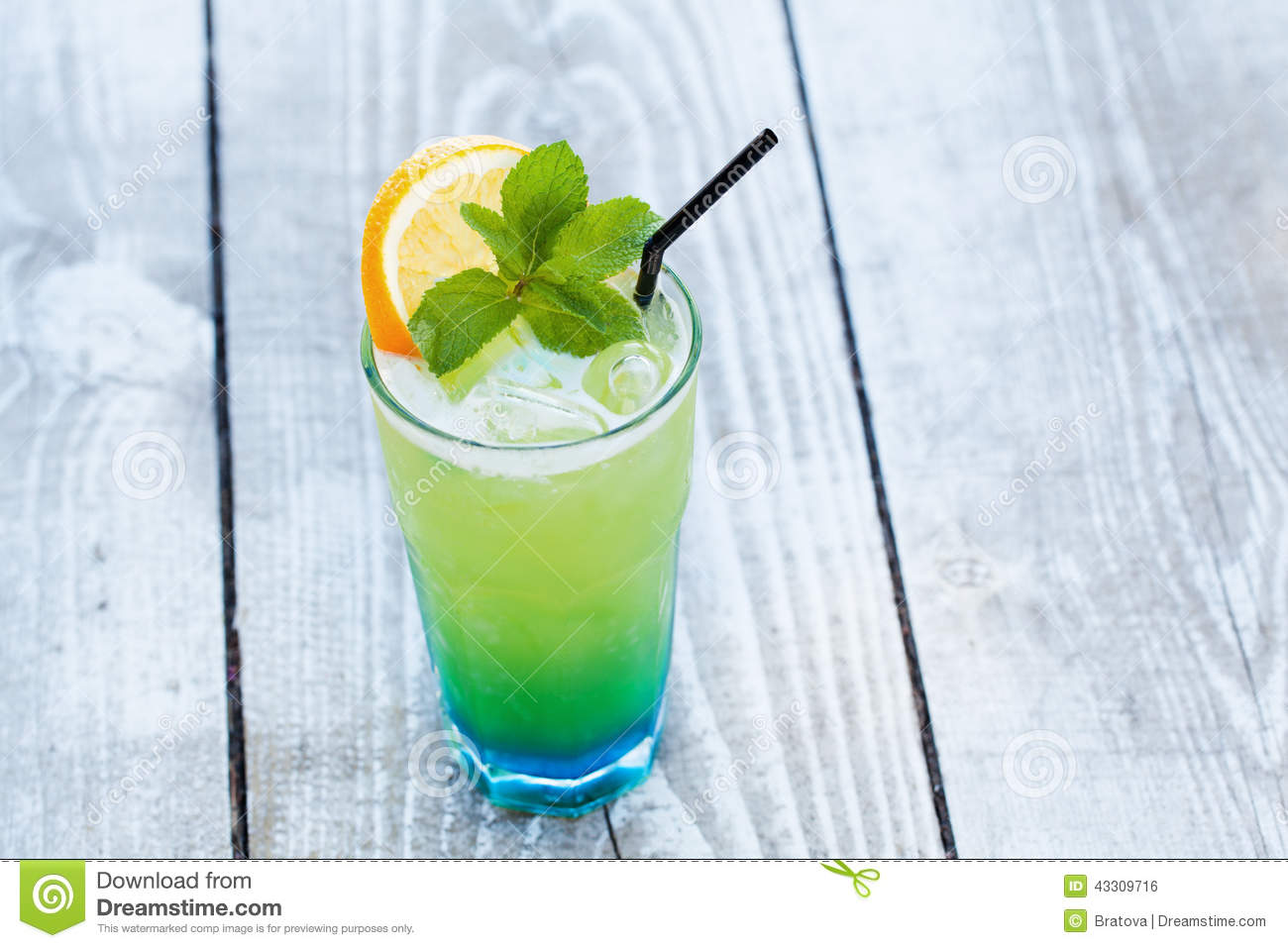 Blue green cocktail with orange and mint stock photo for Orange and blue cocktails