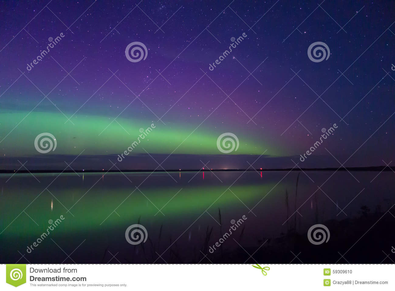 Blue, green, magenta and purple aurora borealis reflected over Long ...